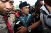 Anggota DPR Fraksi Partai Golkar Ade Komarudin menjawab pertanyaan wartawan seusai menjalani pemeriksaan di gedung KPK, Jakarta, Kamis (13/7).