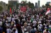 Ribuan massa gabungan ormas Islam melakukan aksi demonstrasi di depan gedung DPR RI di Jakarta, Jumat (29/9).
