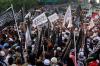 Dalam aksinya, mereka menyuarakan tolak Perppu Ormas yang ditandatangi oleh Presiden Jokowi dan menolak kebangkitan paham PKI.
