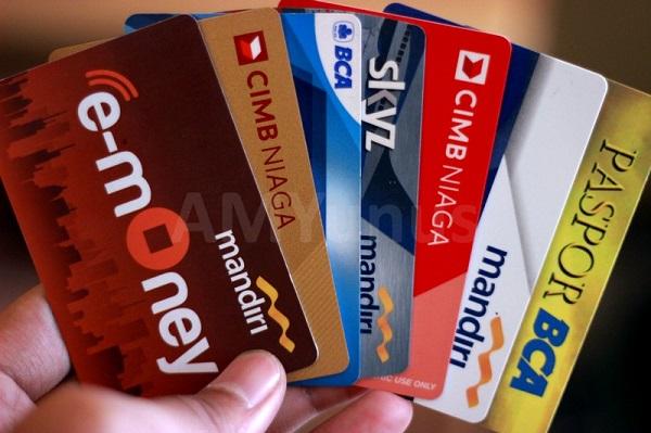Menelaah Dampak Kebijakan Transaksi Non Tunai