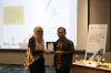 Pemberian Plakat Narasumber kepada Bapak Hartowo, Operational & Marketing Manager dari PT. Surveyor Indonesia (PTSI), Selasa (30/18). Foto: Event & Training Hukumonline