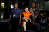 Tersangka Hakim Pengadilan Negeri Tangerang, Wahyu Widya Nurfitri mengenakan rompi oranye usai terjaring OTT KPK, Selasa (13/3).